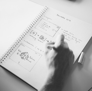 Close up of notebook with sketches for solvers new website design